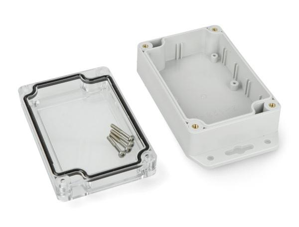 Obudowa plastikowa Kradex Z128 JpU ABS-PC z uszczelką i mosiężnymi tulejkami IP65 - 105x70x40mm jasna z uszami