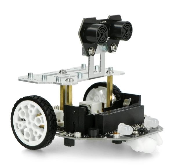 Robot edukacyjnymicro:Maqueen Plus. Robot nie jest zawartością zestawu, można go kupić osobno w naszym sklepie.
