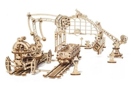 Manipulator szynowy to element serii Mechanical Town.